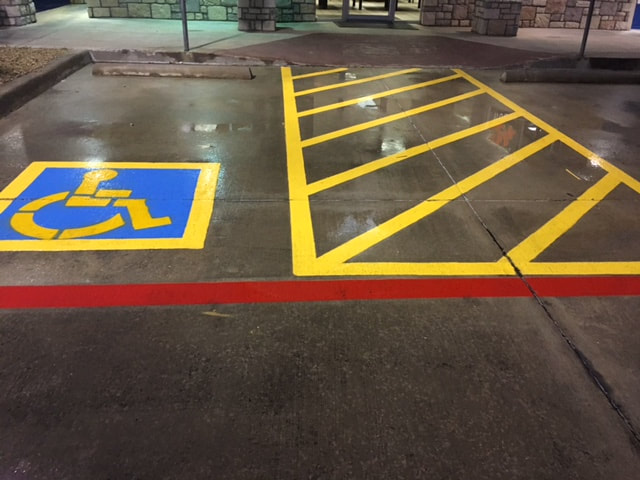 Handicap Stall Stenciling Yellow and Blue