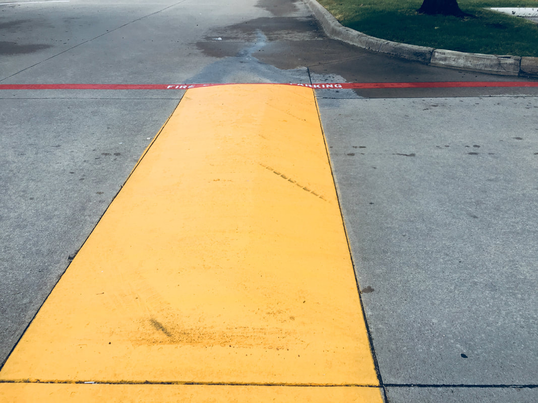 Parking-Lot-Speed-Bumps-Painted-Yellow